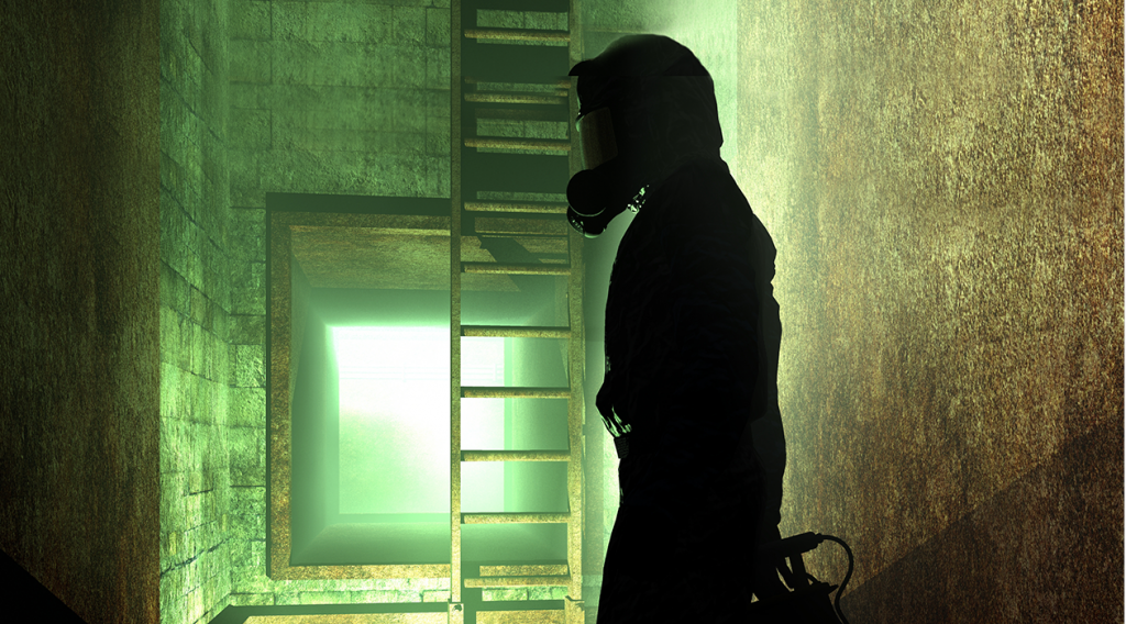 Man standing in a tunnel in green lighting