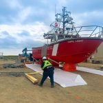 Worker working on the Canadian Coast Guard vessel