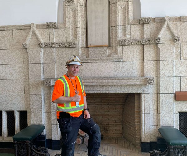Worker posing with Centre Block Architecture